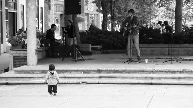 Toddler Watching Musician.jpg