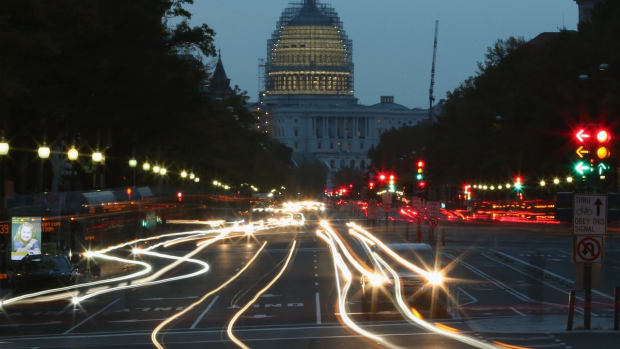 Nighttime photo showing a street approaching the Capitol building