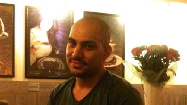 Photo of Mustafa Mousa sitting in a restaurant