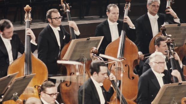 The double bass section of the Vienna Philharmonic Orchestra in performance, circa 1975.
