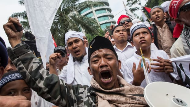 Members of various hardline Muslim groups celebrate after Jakarta's former governor, Basuki Tjahaja Pernama, was convicted of committing blasphemy.