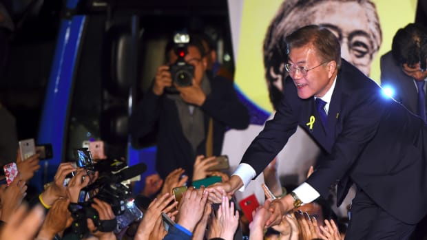 South Korean President-elect Moon Jae-in greets supporters.