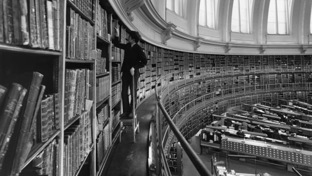 A black and white photograph of a library