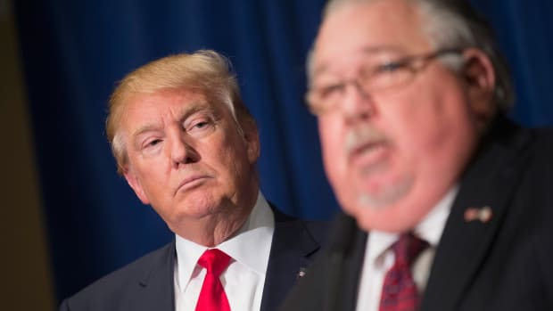 Sam Clovis speaks during a news conference with Donald Trump ahead of a rally in Grand River Center, Iowa, on August 25th, 2015.