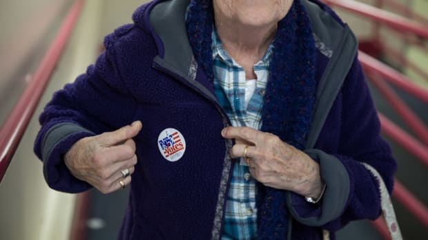 A woman receives a sticker after casting her vote at the Immaculate Conception Church on November 8th, 2016, in Penacook, New Hampshire.