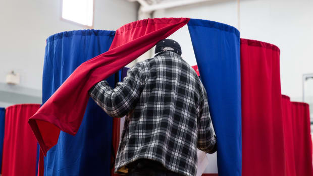A man casts his vote at Amherst Street Elementary School on November 8th, 2016, in Nashua, New Hampshire.