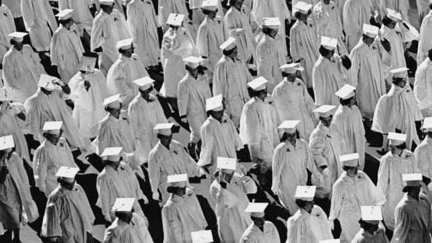 A black and white image of graduates in their robes.