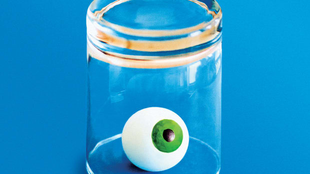 An illustration of an eyeball inside an upturned glass.