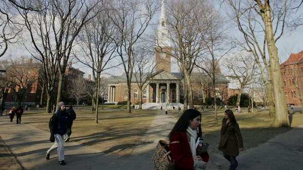Students walking across the campus at Harvard University.