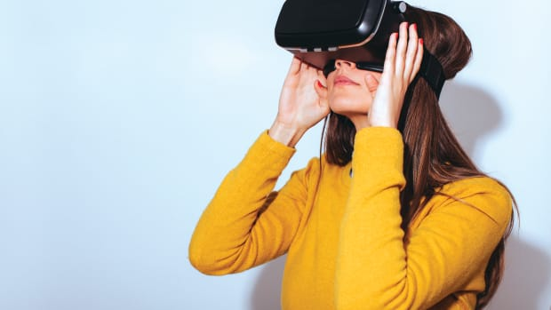 A woman wearing a virtual reality device.