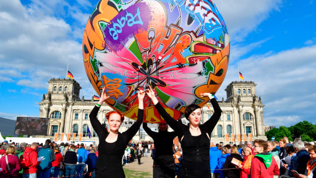 Performers carry a giant graffiti ball during the opening Mass of the Kirchentag (Church Day) festival in Berlin, Germany, celebrating the 500th anniversary of the Reformation, on May 24th, 2017.