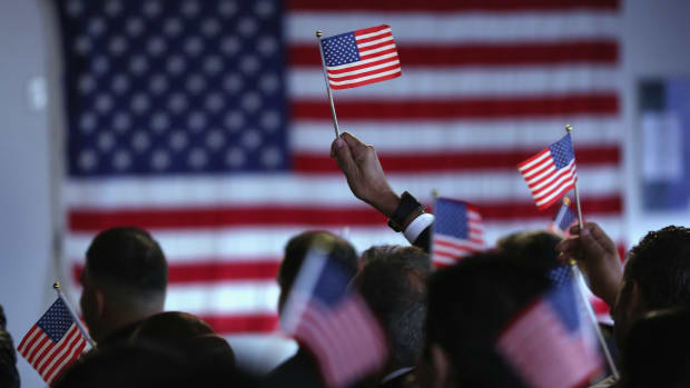 New American citizens celebrate at a naturalization ceremony in Newark, New Jersey.