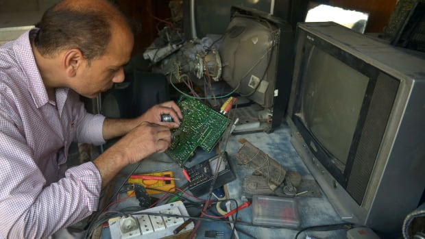 Indian television repairman Balwinder Pal works at his shop in Amritsar on May 26th, 2017.