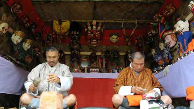 Bhutanese men prepare traditional shoes at a Folk Heritage Museum in Thimphu on June 1st, 2017, during a visit there by Japanese Princess Mako.