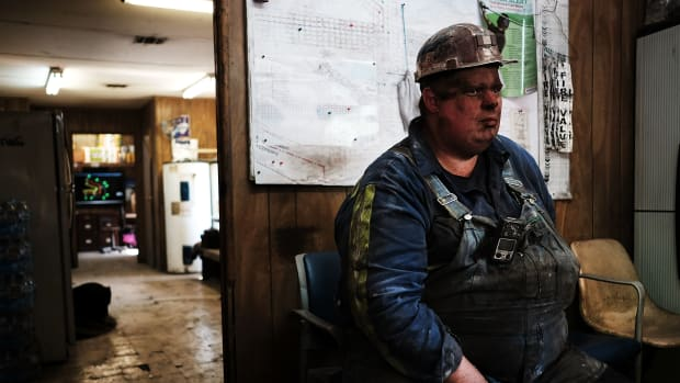 A coal miner takes a break after his shift at a small mine on May 19th, 2017, outside the city of Welch, West Virginia.