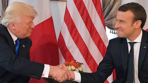 President Donald Trump and French President Emmanuel Macron shake hands ahead of a working lunch on the sidelines of the NATO summit in Brussels on May 25th, 2017.