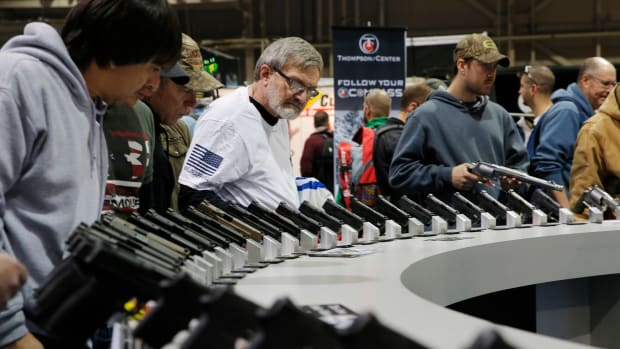 Visitors view gun displays at a National Rifle Association outdoor sports trade show on February 10th, 2017, in Harrisburg, Pennsylvania.