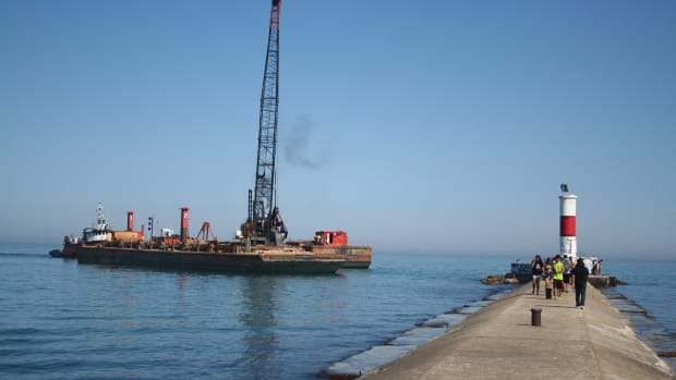 The Waukegan Harbor is dredged.