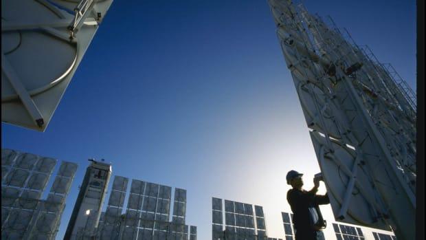 A technician servicing photovoltaic cells in a solar energy farm in Albuquerque, New Mexico.