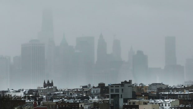 The New York City skyline, shrouded in snow and fog.