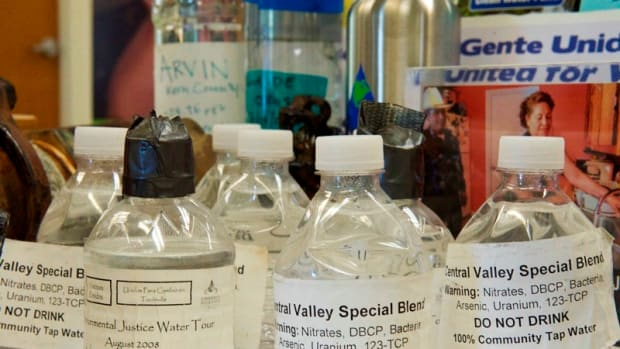 Bottles filled with contaminated tap water from San Joaquin Valley communities are on display at the Visalia, California, office of the Community Water Center, which advocates for clean drinking water for all.