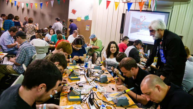 Newcomers attend a coding workshop at an Orlando maker faire.