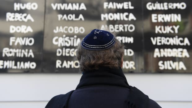 A man prays in front of the Argentine Israelite Mutual Association Jewish community center during the commemoration of the 23rd anniversary of the terrorist bombing attack that killed 85 people and injured 300, in Buenos Aires on July 18th, 2017.