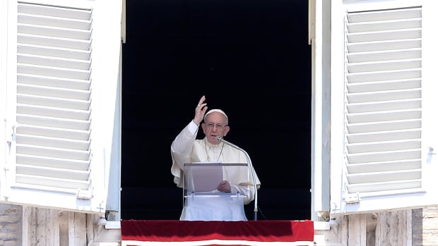 Pope Francis blesses the crowd attending the Angelus prayer in St. Peter's Square at the Vatican on July 23rd, 2017.
