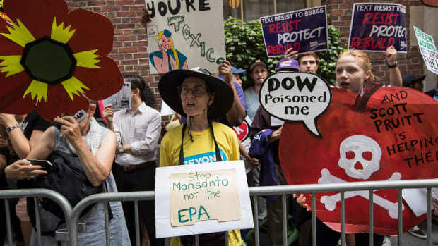 Environmental activists protest outside of the Harvard Club, where Environmental Protection Agency Administrator Scott Pruitt was scheduled to speak on June 20th, 2017, in New York City.