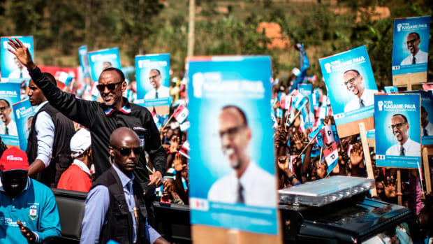 Incumbent Rwandan President Paul Kagame (L) greets a crowd of supporters as he arrives for a campaign rally on July 31, 2017 in Gakenke ahead of August 4 presidential election. Kagame and his Rwanda Patriotic Front (RPF) party have held an iron grip on power since overthrowing the extremist Hutu regime, which perpetrated the 1994 genocide of 800,000 Tutsis.