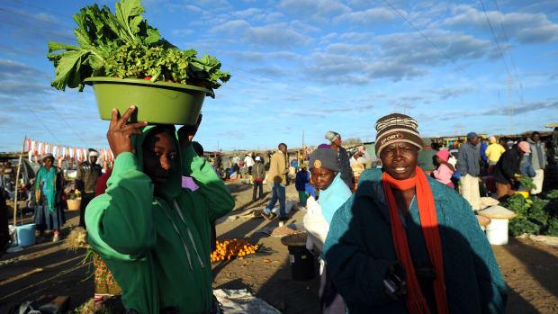 Zimbabwean women shop for vegetables in Jambanja market in Seke, south of Harare.