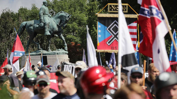 The statue of Confederate General Robert E. Lee stands behind a crowd of hundreds of white nationalists, neo-Nazis, and members of the alt-right during the Unite the Right rally on August 12th, 2017, in Charlottesville, Virginia.