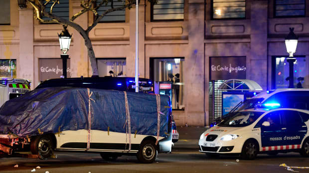 The van that ploughed into a crowd, killing at least 13 people and injuring around 100 others is towed away from the Rambla in Barcelona on August 18th, 2017. A driver deliberately rammed a van into a crowd on Barcelona's most popular street on August 17th, 2017, police said. Officers in Spain's second-largest city said the ramming on Las Ramblas was a 'terrorist attack'. The driver of a van that mowed into a packed street in Barcelona is still on the run, Spanish police said.