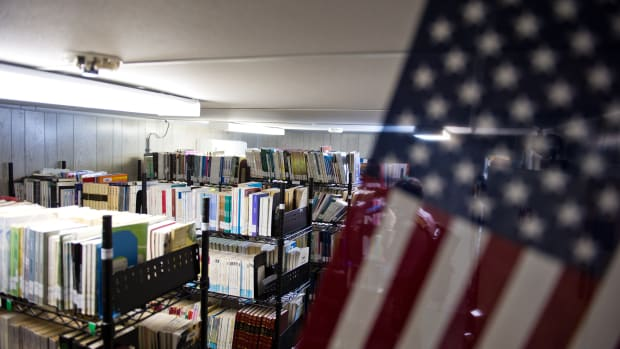 This photo reviewed by the U.S. military and made during an escorted visit shows bookshelves in the detainee library in Camp Echo detention facility in Guantanamo Bay, Cuba, on April 9th, 2014.
