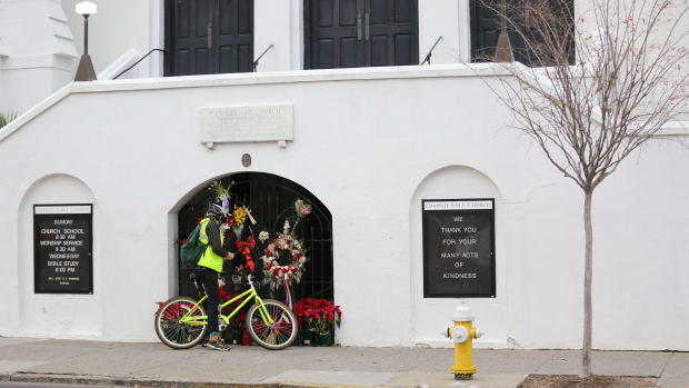 A man stops to observe the makeshift memorial in front of Mother Emanuel AME Church in downtown Charleston, South Carolina, on January 4th, 2017.