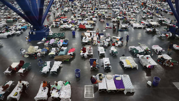 People take shelter at the George R. Brown Convention Center after floodwaters from Hurricane Harvey inundated the city on August 29th, 2017, in Houston, Texas. The evacuation center, which is overcapacity, has already received more than 9,000 evacuees, with more arriving.