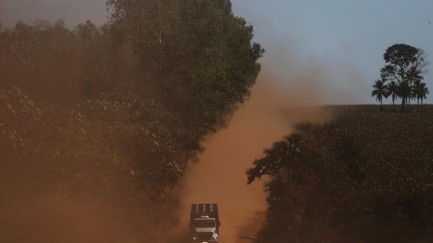 A truck travels in a deforested section of the Amazon rainforest on June 28th, 2017.