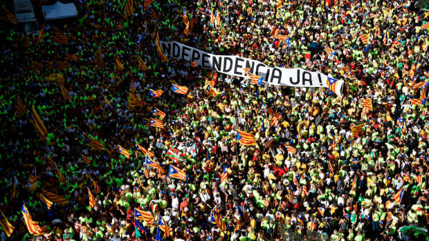 "People hold a banner reading ""Independence now!"" in Catalan as they gather during a pro-independence demonstration, on September 11th, 2017, in Barcelona during the National Day of Catalonia. Hundreds of thousands of Catalans were expected to rally to demand their region break away from Spain in a show of strength three weeks ahead of a secession referendum banned by Madrid. The protest coincides with Catalonia's national day, the ""Diada,"" which commemorates the fall of Barcelona in the War of the Spanish Succession in 1714 and the region's subsequent loss of institutions and freedoms."