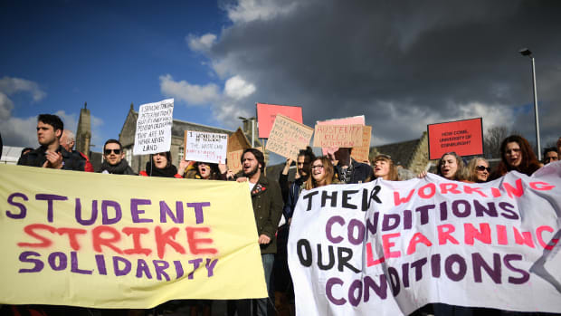 University workers attend a rally outside the Scottish Parliament on March 8th, 2018, in Edinburgh, Scotland. Politicians, students, and union officials joined Scottish university staff as they demonstrated over pensions changes.