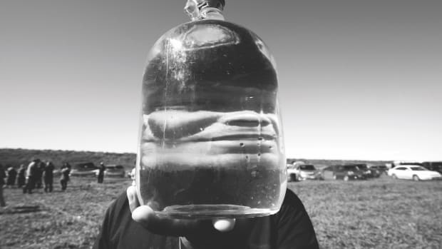 A jug of purified water, reinforcing the ongoing role of the Water Protectors.