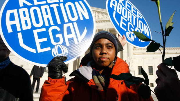 A pro-choice activist holds a sign in front of the U.S. Supreme Court on January 22nd, 2009, in Washington, D.C.