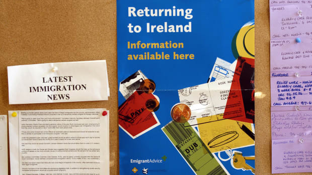 A poster advertises information about returning to Ireland at the Aisling Irish Community Center in Yonkers, New York.