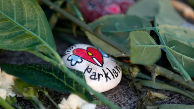 A painted rock sits outside one of the makeshift memorials at Marjory Stoneman Douglas High School in Parkland, Florida, on February 27th, 2018.