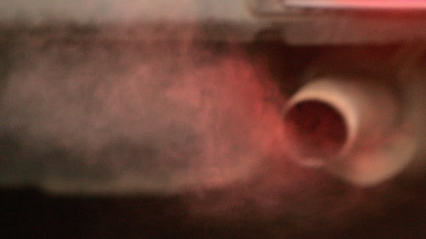 An exhaust pipe releases fumes.