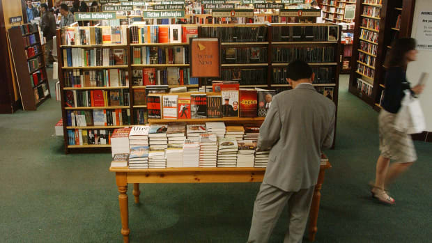 A customer shops at Barnes and Noble in Rockefeller in New York City.