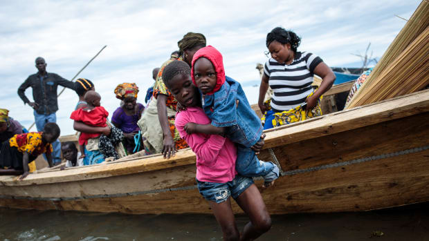 Refugees from Tchomia in the Democratic Republic of Congo arrive on boat at the Nsonga landing site on April 9th, 2018, in Nsonga, Uganda.