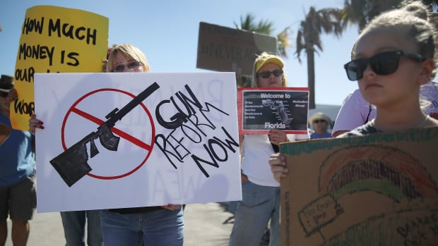 Activists protest in front of Kalashnikov USA, a gun manufacturer that makes an AK-47 rifle, on February 25th, 2018, in Pompano Beach, Florida.