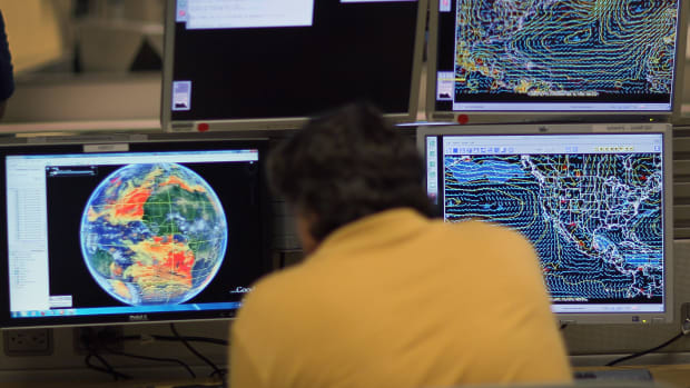 Senior hurricane forecaster Jack Beven studies computer models as he tracks Tropical Storm Arlene at the National Hurricane Center.