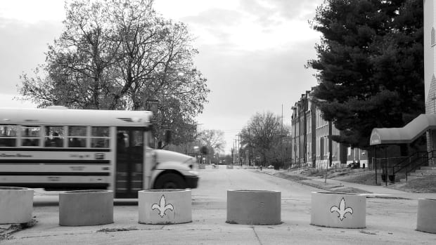 Schoemehl pots, concrete sewer pipes filled with dirt named for former St. Louis Mayor Vincent Schoemehl. These barricades, ubiquitous in St. Louis, block off the heavily white neighborhoods along Delmar Boulevard, the city's infamous racial dividing line.