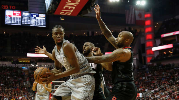 Andrew Wiggins of the Minnesota Timberwolves (left) during game one of the first round of the 2018 NBA Playoffs in Houston, Texas, on April 15th, 2018.
